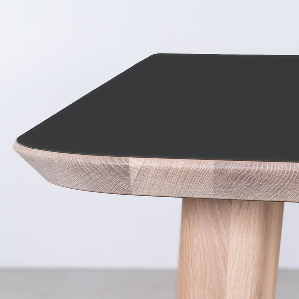 bSav & Okse Tomrer Table Black Fenix top - Oak Whitewash legs