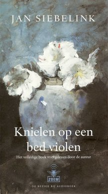Jan Siebelink Knielen op een bed violen