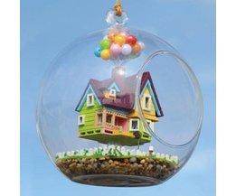 Miniatuur Bouwpakket Vliegend Poppenhuis in Glazen Bol