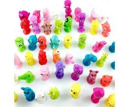 Koop 10 stks/partij Kinderen Little Kleurrijke Cartoon Oceaan Dier Actiefiguren Speelgoed Mini Monster Sucker Capsule Model