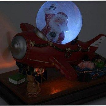 Kersttafereel met sneeuw, verlichting en muziek
