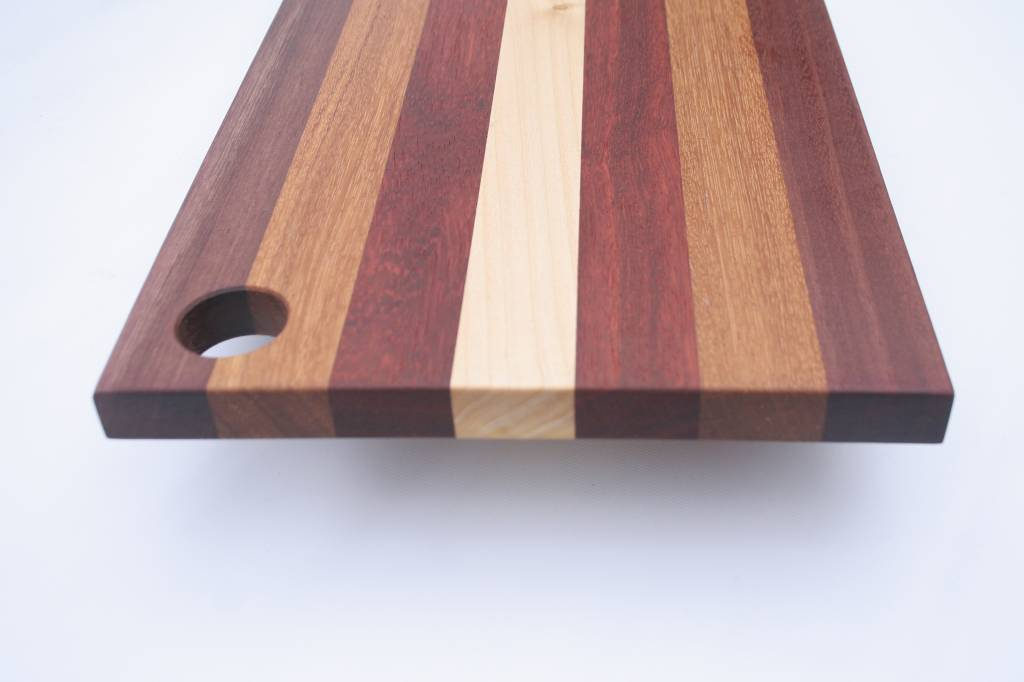 Luxury Breadboard, made of maple, purpleheart, padouc and afzelia.