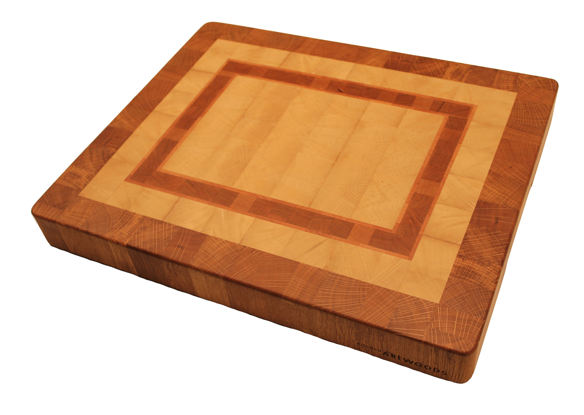 end grain cuttingboard made of hornbeam with a galloon of cherry and beech and a rim of oak