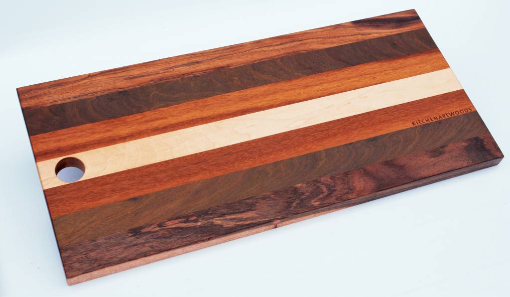 Bread board made of the Brazilian hardwoods, tigerwood, greenheart, curupay a;ongside Dutch maple. A suitable size of 23x50 cm.
