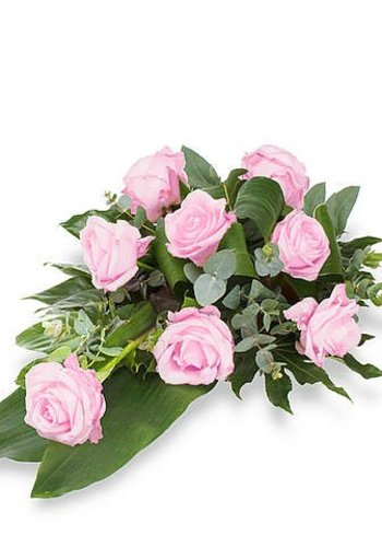 Roze rozen rouwbloemstuk