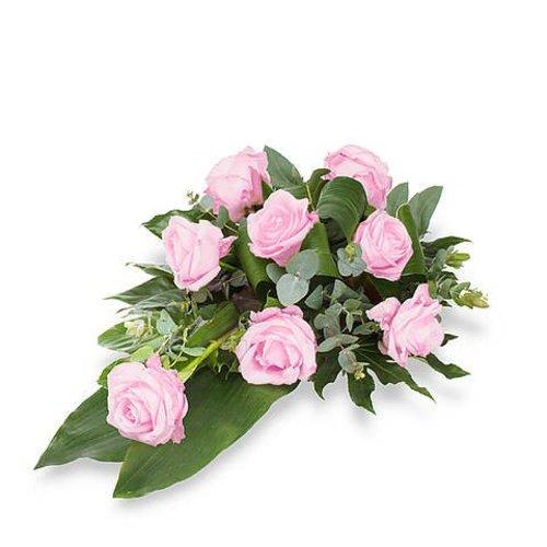 Roze rozen rouwboeket