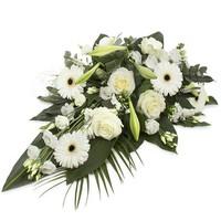 Divers wit rouwbloemstuk
