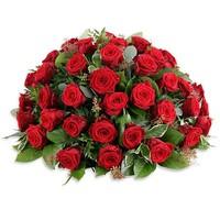 Rouwboeket met rode roze
