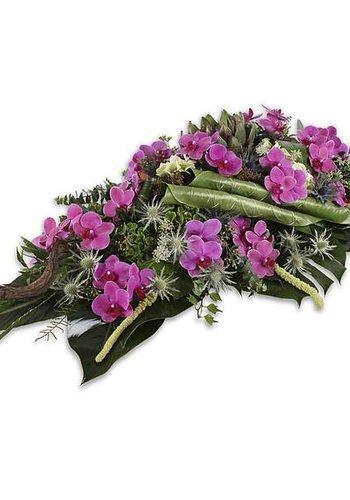 Paars groen uitvaartbloemen