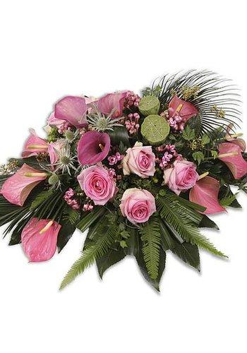 Roze groen uitvaartbloemen