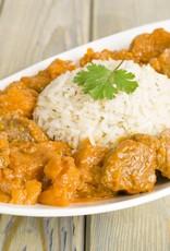 Kip-kerrie bakschotel met kip, courgette, bospeentjes en kerrie