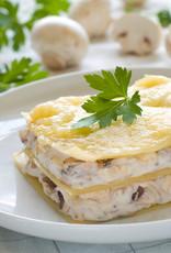 Kiplasagne met kerrie, ui, champignons en courgette