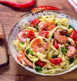 Gamba's met groente, noedels en zoetzure saus