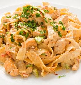 Penne pasta met kip en groenten