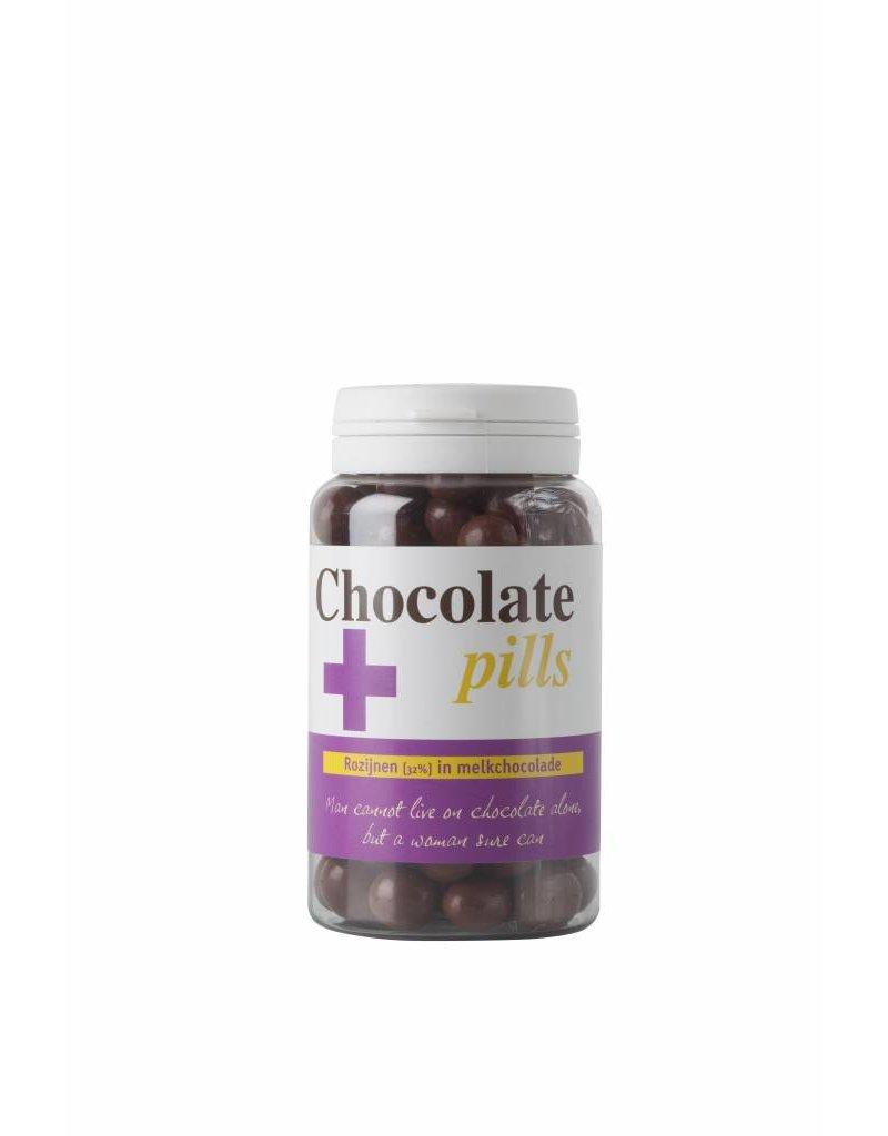 Chocolate pills with raisins