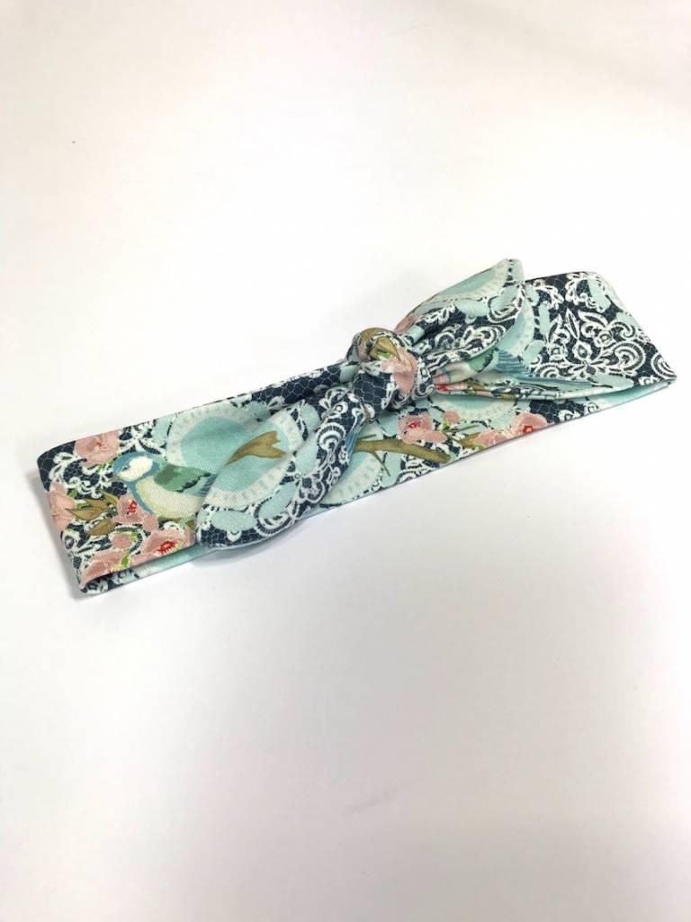 Blauwe haarband strik met vogel/bloem print