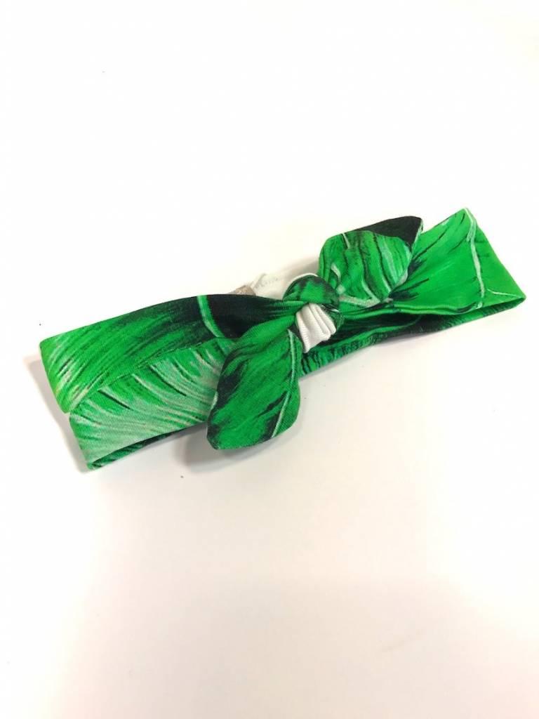 Groen-witte haarband strik met bladeren dessin