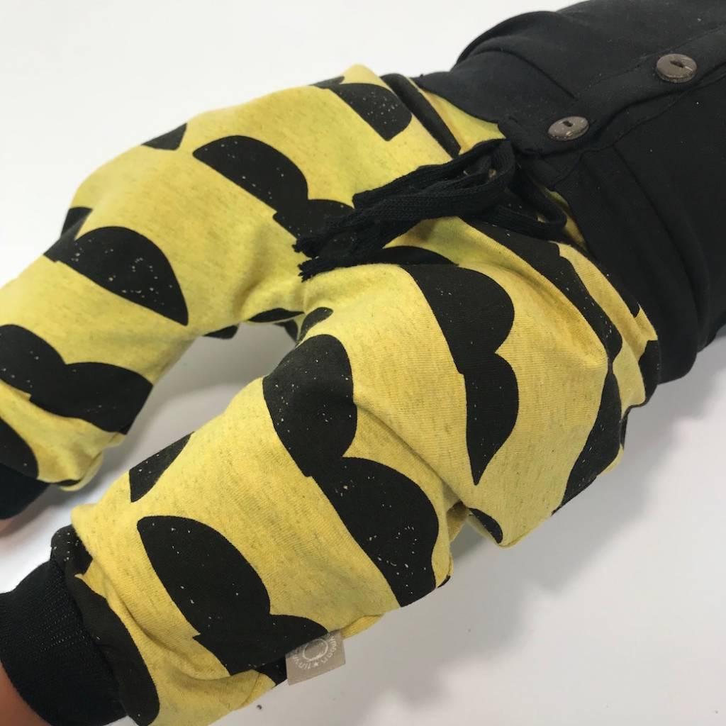 Harembroekje geel/zwart met keienmotief