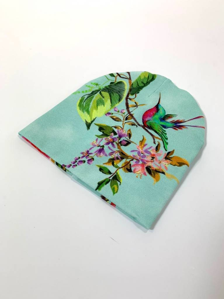 Mint newborn mutsje met vogels en bloemen