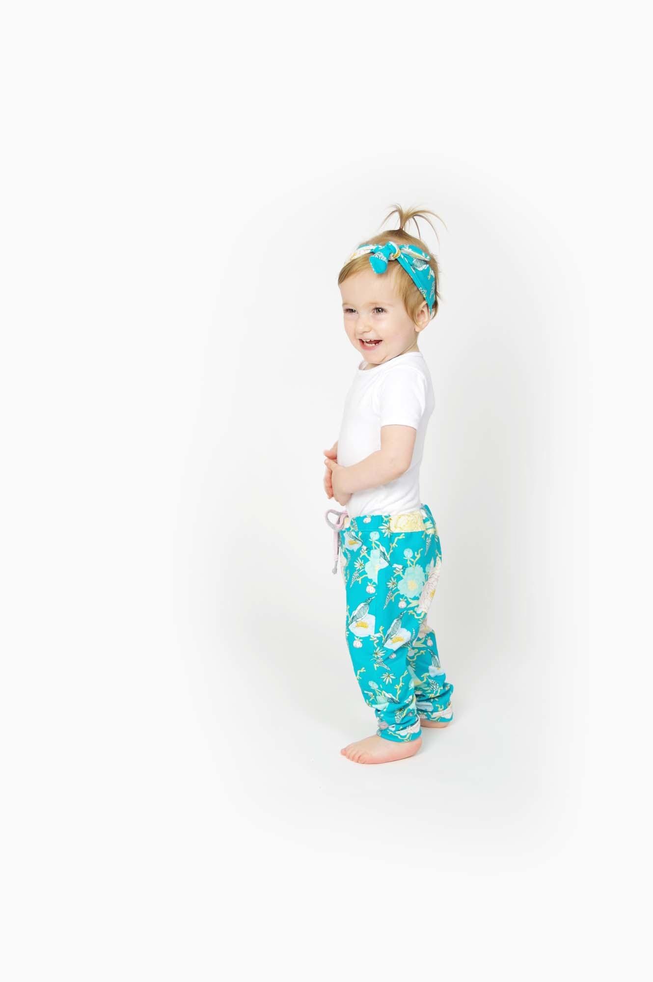 Blauwe haarband strik met Oosterse bloem/vogelprint