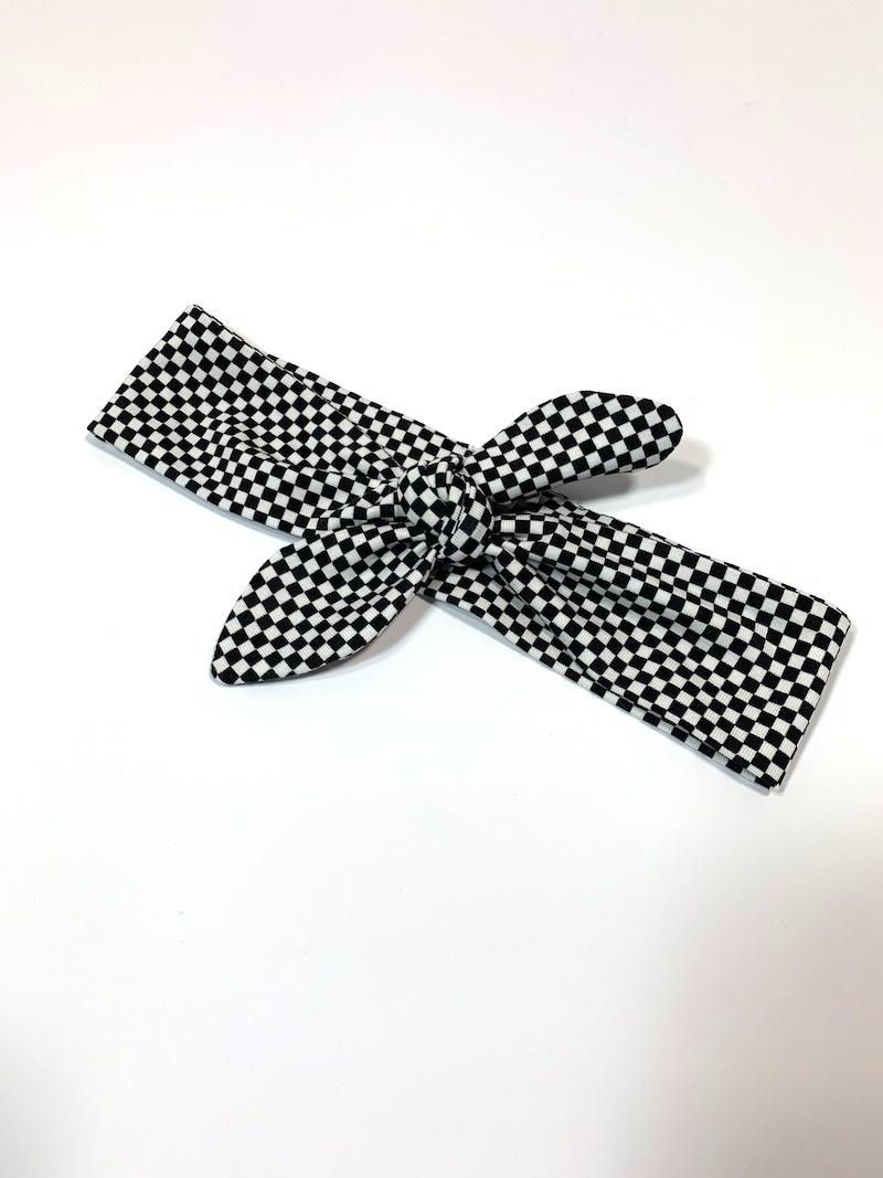 Haarband strik met zwart/witte ruitprint