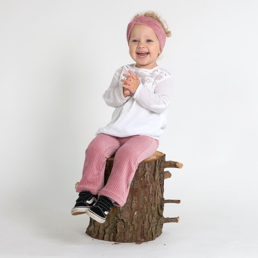 Flared broek van brede rib in roze