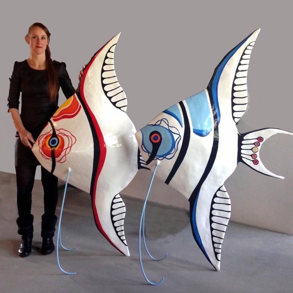 Tall art sculptures by Jenny Derksen