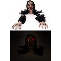 Monster uit de grond met handen en licht