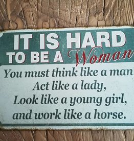 Tekstbord  ¨It is hard to be a woman¨