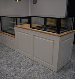 Counter or bar tailored to your wishes suitable for installing a refrigerated display case