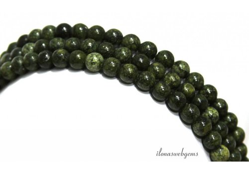 Serpentine beads around A quality about 6mm