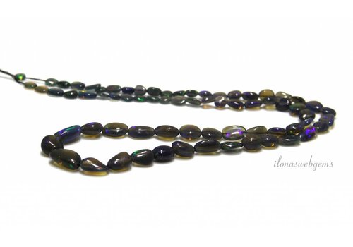 Black Edelopaal beads about 9x6x2.5mm