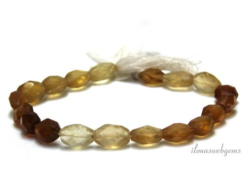 Hessonite beads faceted oval 10x7mm