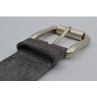 Stoere 4cm riem volledig gevuld met oud zilveren studs en nikkelvrije rolgesp