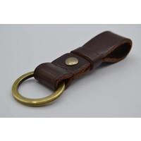 Deze bruine vintage sleutelhanger is te personaliseren met 30 karakters of een logo.