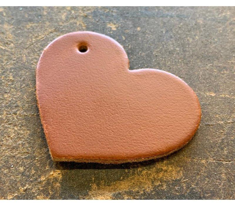 Sleutelhanger in de vorm van een hart met een zilveren sleutelring.