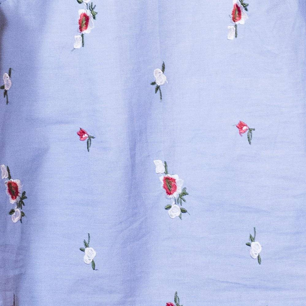 La Maison Victor Blauwe stof met borduursel