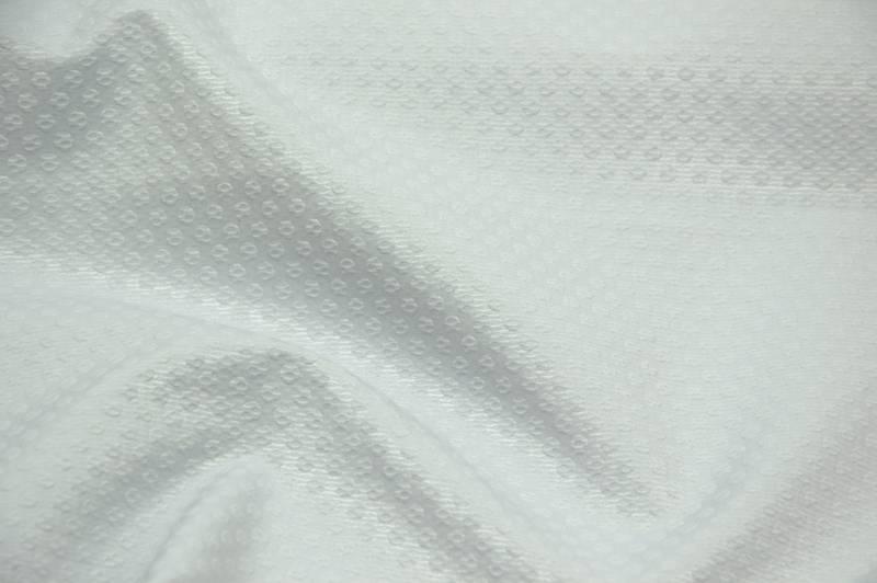 Witte piqué glanzend met reliëf