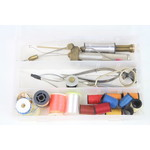 Tacklebox filled with fly tying  tools and binding threads