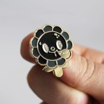 Megalopolitan Bloom pin (Black & Gold) by Squink