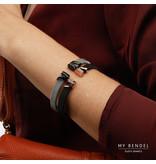 Bless Stijlvolle bangle van zwart gevlochten edelstaal met sierlijke rosékleurige uiteinden met zirkonia stenen