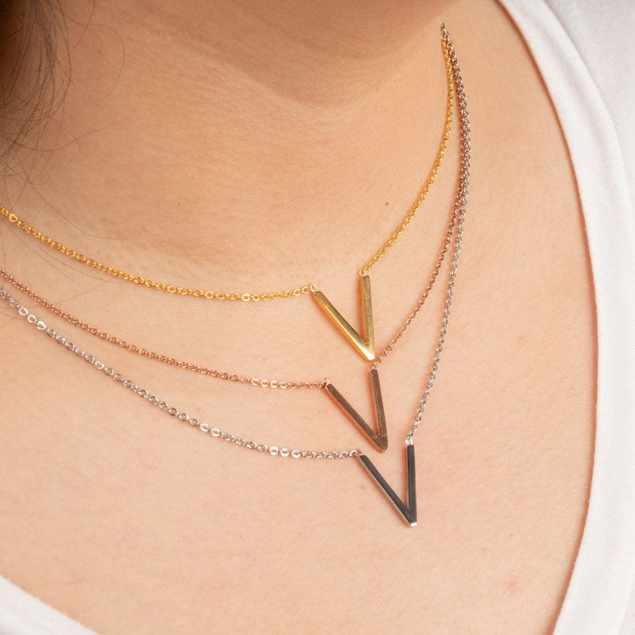 Picolo Rose-colored stainless steel necklace with V symbol