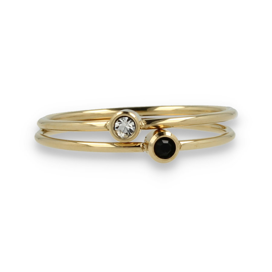 Picolo Zirconia gold ring set with cubic zirconia rings in black and white
