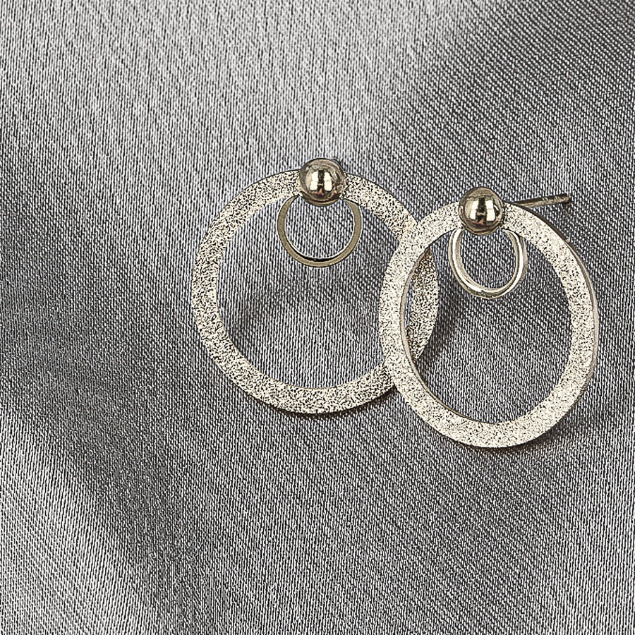 Picolo Zilveren oorbellen met stardust cirkel