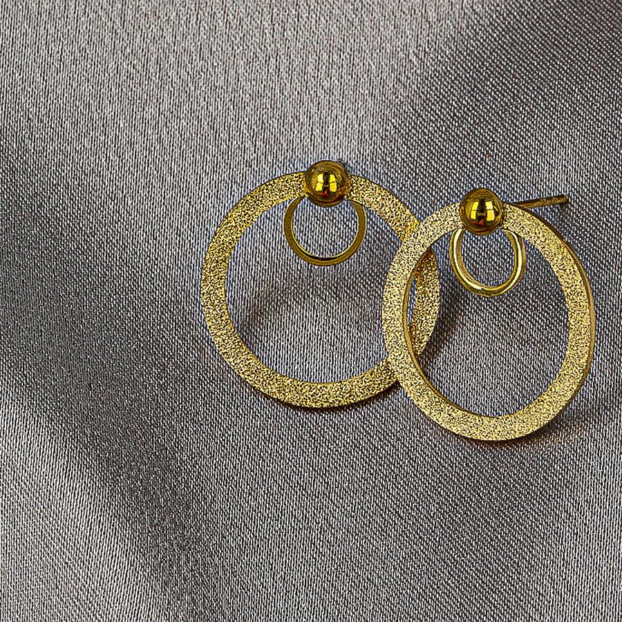 Picolo Gouden oorbellen met stardust cirkel