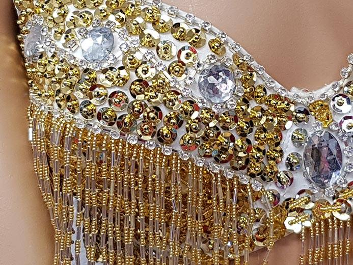 Gold bra with silver and gold elements