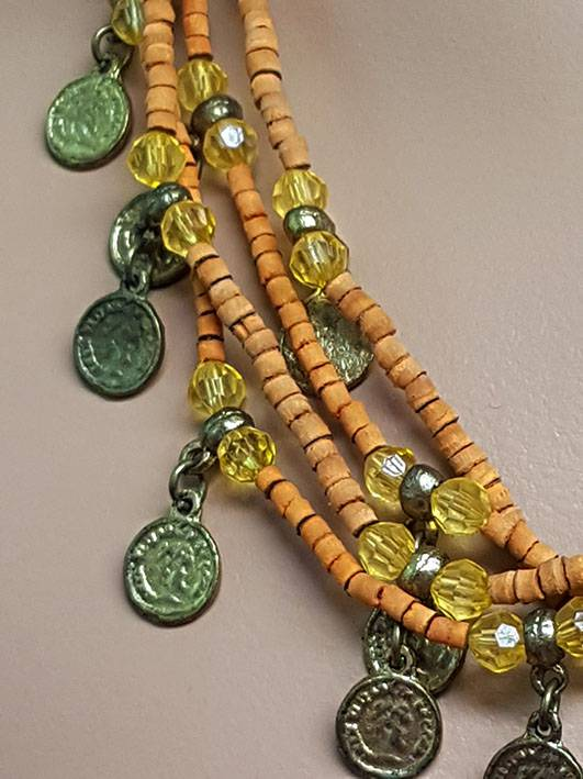 Necklace with wooden orange beads and old gold coins
