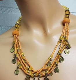 Necklace with orange beads and old coins