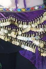 Hüfttuch in lila mit Steinen und münzen
