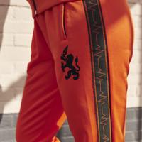 Q-Dance track pants orange/black